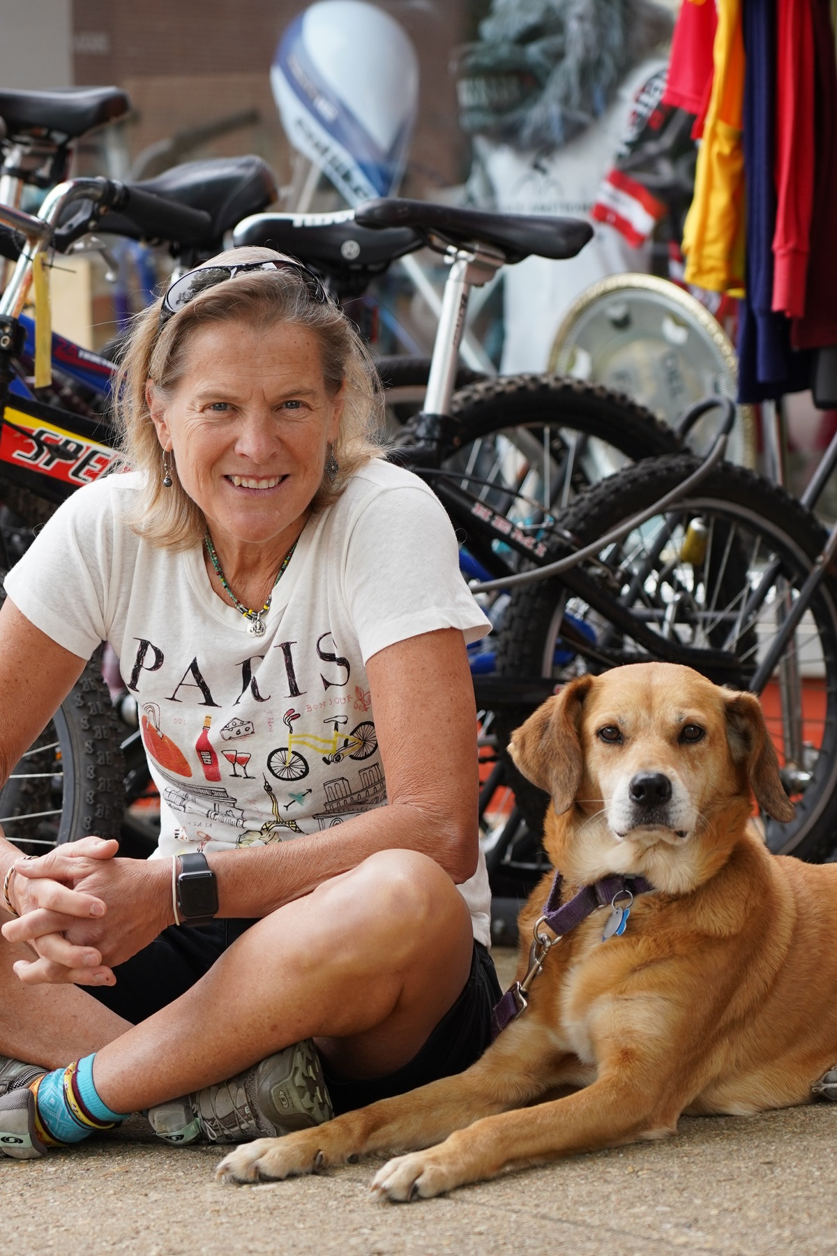 Patti Armstrong and shop dog Zipper.